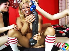 Maxine gets an enormous dildo in her Pussy from her Kinky girlfriends Yumi and Jaden