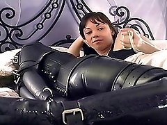 Dominant lady keeps bound les slave in bed